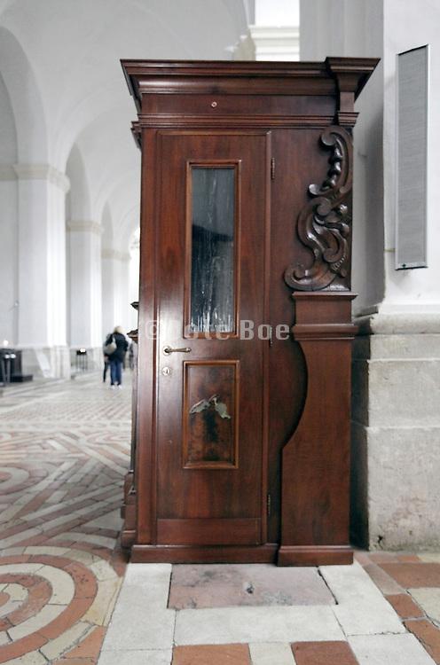 confessor entree door of a confession booth