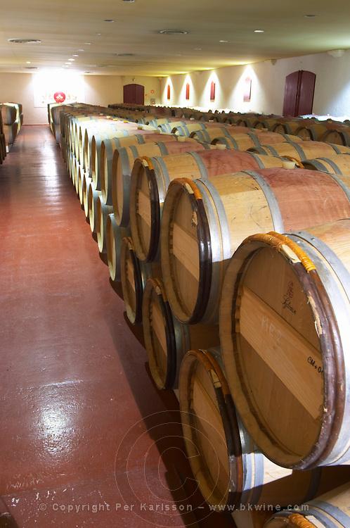 barrel aging cellar red wine chateau fieuzal pessac leognan graves bordeaux france