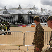 British army personal patrolling around Olympic Park in Stratford, the main venue for the 2012 London Olympic Games. Olympic Park, Stratford, UK. 13th July 2012. Photo Tim Clayton