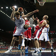 Anadolu Efes's Birkan Batuk (L) during their Turkish Basketball League match Anadolu Efes between Tofas at the Abdi ipekci Arena in Istanbul, Turkey on Tuesday, 24 December, 2013. Photo by TURKPIX