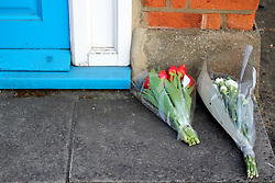 © Licensed to London News Pictures. 08/04/2013. London, UK Flowers left on the doorstep of former Prime Minister Margaret Thatcher's constituency offices in Finchley, London, the day after she died from a stroke aged 87. Photo credit : Clare O Hagan/LNP