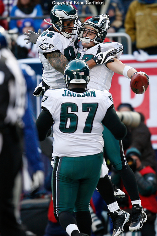 11 Jan 2009: Philadelphia Eagles tight end L.J. Smith #82 and offensive lineman Jamaal Jackson #67 celebrate with Philadelphia Eagles tight end Brent Celek #87 after Celek scored a touchdown during the game against the New York Giants on January 11th, 2009.  The  Eagles won 23-11 at Giants Stadium in East Rutherford, New Jersey.