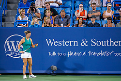 August 15, 2018 - Cincinnati, OH, U.S. - CINCINNATI, OH - AUGUST 15: Simona Halep (ROU) adjusts her strings while there is a break in play during the Western & Southern Open at the Lindner Family Tennis Center in Mason, Ohio on August 15, 2018. (Photo by Adam Lacy/Icon Sportswire) (Credit Image: © Adam Lacy/Icon SMI via ZUMA Press)