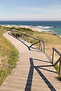 Wooden footpath on beach with sea in background, Cadiz, Andalusia, Spain
