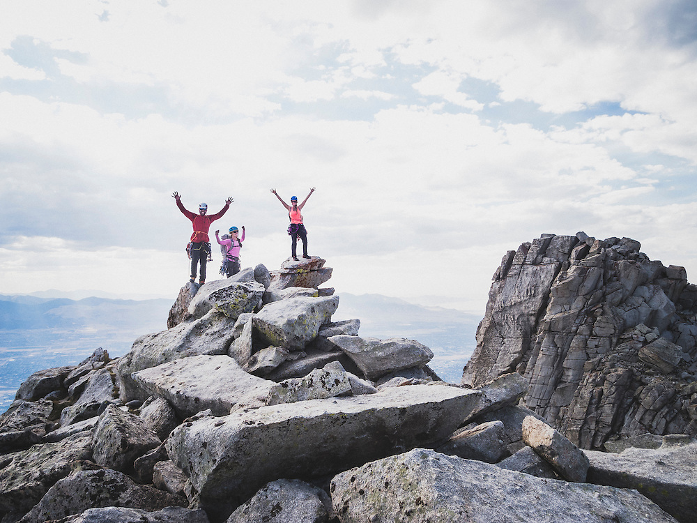 Blake Summers , Cindi Grant, and Julia Geisler stand on top of the south summit of Lone Peak after climbing, Wasatch Range, Utah.