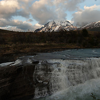 Morning clouds billow over Paine Falls, the Towers of Paine & Monte Almirante Nieto (L) in Torres del  Paine National Park in Patagonia, Chile