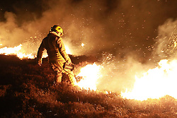 © Licensed to London News Pictures. 08/05/2013. Baitings Reservoir, UK. Fire fighters from Manchester and Pontefract come in to support local fire crew to battle moors fires near Baitings Reservoir  near the M62 throughout the night. Photo credit : Tom Maddick/LNP