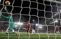 Liverpool's Xherdan Shaqiri (not in picture) scores his side's second goal of the game as Manchester United goalkeeper David de Gea (left) cannot stop the shot from going in during the Premier League match at Anfield, Liverpool.