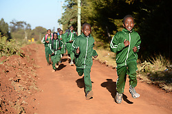 © Licensed to London News Pictures. 02/02/2014. Iten, Kenya. Running in Africa feature. Runners can be spotted everywhere, out training, in the early morning. Photo credit : Mike King/LNP