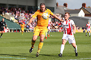 Jon Parkin of Newport county (9) holds off Cheltenham's Jack Barthram.  EFL Skybet football league two match, Newport county v Cheltenham Town at Rodney Parade in Newport, South Wales on Saturday 10th September 2016.<br /> pic by Andrew Orchard, Andrew Orchard sports photography.