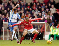 Photo: Leigh Quinnell.<br /> Nottingham Forest v Swindon Town. Coca Cola League 1. 25/02/2006. Nottingham Forests Nathan Tyson holds off Swindons  Jerel Ifil.
