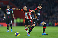 Football - 2019 / 2020 Premier League - Southampton vs. Crystal Palace<br /> <br /> Southampton's Nathan Redmond skips over the challenge from Luka Milivojevic of Crystal Palace during the Premier League match at St Mary's Stadium Southampton <br /> <br /> COLORSPORT/SHAUN BOGGUST