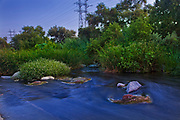 Dusk settles over the Los Angeles River at the Glendale Narrows, Elysian Valley, Los Angeles, California, USA