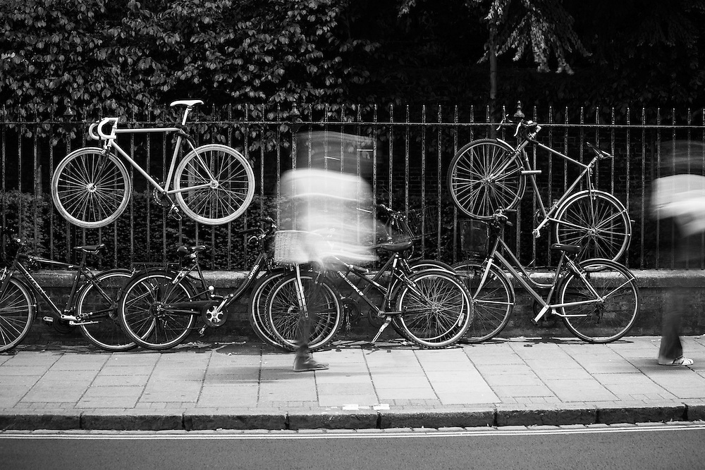 Bicycles attached to a fence in Cambridge, UK.