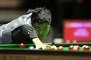Liang Wenbo (Chn) taking a shot. Ronnie O'Sullivan v Liang Wenbo, 1st round match at the Dafabet Masters Snooker 2017, day 1 at Alexandra Palace in London on Sunday 15th January 2017.<br /> pic by John Patrick Fletcher, Andrew Orchard sports photography.