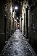 Un carrugio del centro storico di Genova. An alley of the historic center of Genoa.