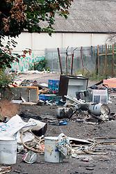 Fly tipped rubbish in rundown area awaiting regeneration Dagenham East London UK