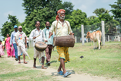 16 September 2018, Sirsiya Tole, Jahada rural municipality, Nepal: A man leads the way, beating the drum, in Sirsiya Tole, Jahada rural municipality, Nepal. Sirsiya Tole is a community inhabited by Santal and Dalit (Musahar) people, who find themselves as the very margin of society in Nepal. Through support from the Nepal Evangelical Lutheran Church, the community has been able to recover and develop flood resilience, and to mobilize to make their voices heard in the local government, as Nepal is transitioning into a federal government system.