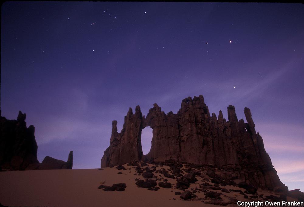 Rock formation at dusk, in the Algerian desert, al Hoggar region - photograph by Owen Franken