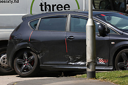© Licensed to London News Pictures. 28/05/2018. Stockport, UK. A visibly damaged car at the scene at The Salisbury Club in the Brinnington area of Stockport, Greater Manchester, where a car collided with pedestrians late last night, killing one man.  A murder investigation has been launched. Police later recovered a black Audi A4 which fled the scene. Photo credit: Joel Goodman/LNP