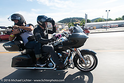 HD's Jeff Wick rides a photographer on the Mayor's Ride during the annual Sturgis Black Hills Motorcycle Rally.  SD, USA.  August 8, 2016.  Photography ©2016 Michael Lichter.
