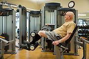 Senior man walking on treadmill