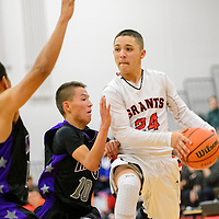 121914  Adron Gardner/Independent<br /> <br /> Grants Pirate Eric Rael (24) looks for an open man over the Miyamura Patriots during the Eddie Peña Holiday Classic in Grants Friday.