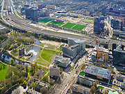Nederland, Noord-Holland, Amsterdam; 16-04-2021; Beethovenstraat met St.Nicolaaslyceum en AkzoNovel Center. Linksonder Beatrixpark. Midden in beeld de Zuidas, Ring A10 met zicht op de velden van AFC (Amsterdam Football Club).<br /> Beethovenstraat with St. Nicolaaslyceum and AkzoNovel Center. On the left Beatrixpark and in the middle of the picture the Zuidas, Ring A10 and a view on the fields of AFC (Amsterdam Football Club).<br /> <br /> luchtfoto (toeslag op standard tarieven);<br /> aerial photo (additional fee required)<br /> copyright © 2021 foto/photo Siebe Swart