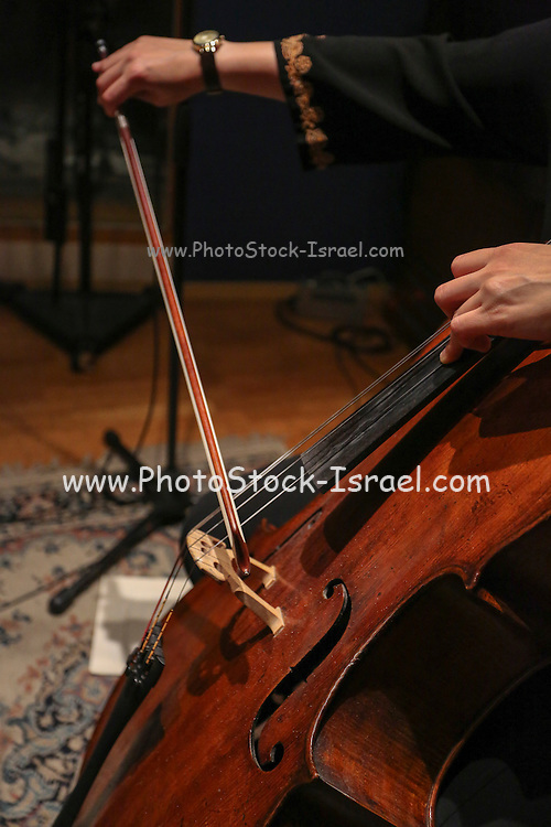 Close up of the cellist's hands and bow while playing a cello