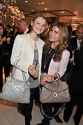 Left to right, AMBER ATHERTON and  at the launch of the new John Lewis Beauty Hall, John Lewis, Oxford Street, London on 8th May 2012.