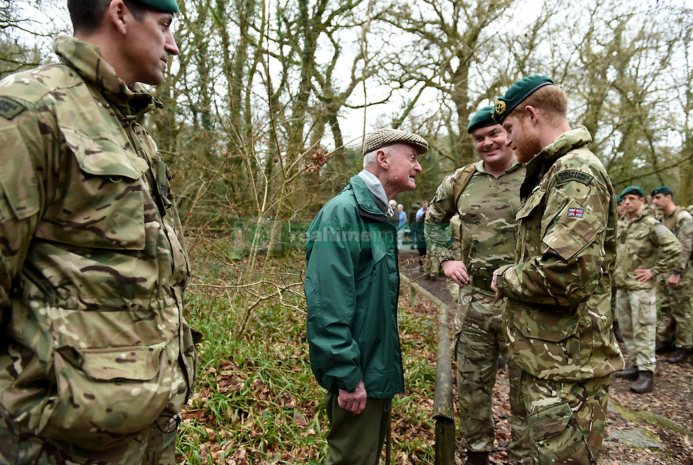 The Duke of Sussex talks to 96 year old former World War 2 Marine Knocker Whiteduring a visit to 42 Commando Royal Marines at their base in Bickleigh.