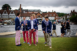 © Licensed to London News Pictures. 28/06/2017. London, UK. A group of man wearing the colours of Malvern Preparatory School rowing team attend day one of the Henley Royal Regatta, set on the River Thames by the town of Henley-on-Thames in England.  Established in 1839, the five day international rowing event, raced over a course of 2,112 meters (1 mile 550 yards), is considered an important part of the English social season. Photo credit: Ben Cawthra/LNP
