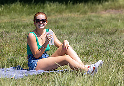 Licensed to London News Pictures. 14/06/2021. London, UK. Sunbather Carys Cannon 20 from Southfields, enjoys the warm sunshine on Wimbledon Common southwest London today. Weather experts have forecast warm weather for the next few days for the South East and London with temperatures predicted to hit up to 30c. Photo credit: Alex Lentati/LNP