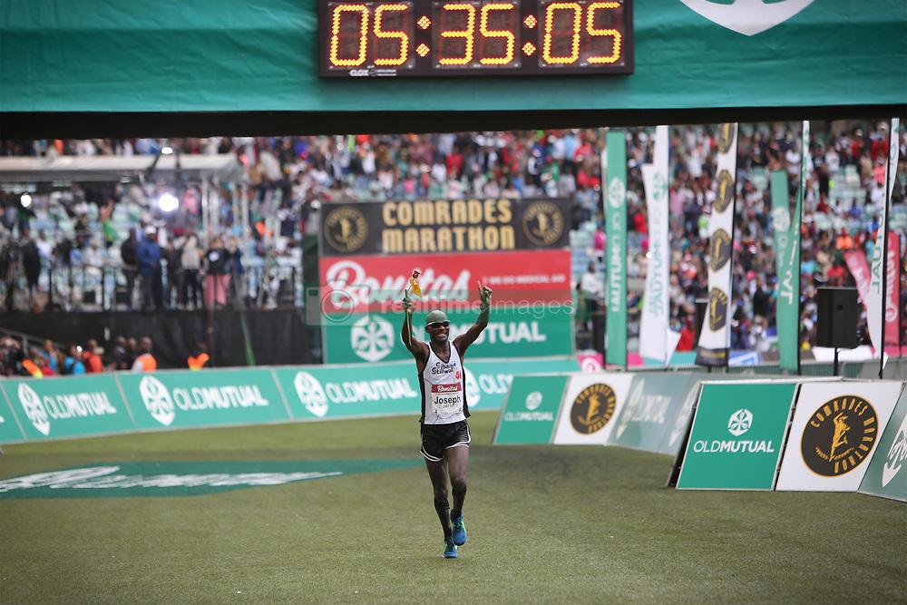 10062018 (Durban) A 2nd position Joseph Mphuthi, RSA (5:35: 09) run towards the finnish line during the 2018 Comrades marathon in Durban.<br /> Picture: Motshwari Mofokeng/ANA
