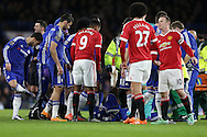 Kurt Zouma of Chelsea lies injured after falling awkardly as he attemted to control the ball in the air. Barclays Premier league match, Chelsea v Manchester Utd at Stamford Bridge in London on Sunday 7th February 2016.<br /> pic by John Patrick Fletcher, Andrew Orchard sports photography.