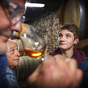 Cognac grower-winemaker Olivier Roy, a key supplier at Martell Cognac, the region's oldest great house, with his father and son in their distillery. Martell works with 1,200 suppliers across the Cognac region and supplies its luxury spirits around the world, especially in the USA and China.In 1715, Jean Martell, a young merchant originally from Jersey, created his own trading business at Gatebourse in Cognac, on the banks of the Charente River, and thus founded one of the very first cognac houses. Martell used grapes from the vineyards in the Borderies subregion, and used Tronçais oak for its casks, this made a combination that resulted in an exceptionally smooth cognac.