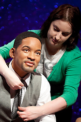 © Licensed to London News Pictures. 22/05/2013. London, UK. Wardrobe assistant, Luisa Compobassi, adjusts the tie on a waxwork figure of rapper, actor and producer Will Smith after he was placed on a sofa alongside actor George Clooney and Harry Potter actress Emma Watson (not shown). The former Fresh Prince of Bel Air star today (22/05/2013) took his place in Madame Tussauds 'A-List' party in London. Photo credit: Matt Cetti-Roberts/LNP