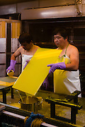 Staff apply the gelatine mixture to the glass printing plates. Benrido collotype atelier, Kyoto, Japan, October 13, 2015. The Benrido collotype atelier in Kyoto was founded in 1887 and is the only full-scale commercial collotype atelier in the world. Collotype is a historic photographic printing process that makes use of plates coated in gelatine. It produces prints of unrivalled quality.