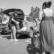 Richard Stellar, founder of The ManKind Project, hands out bags with food and essentials like wipes, toilet paper and kids items to those in need in West Hills during the Covid19 crisis.