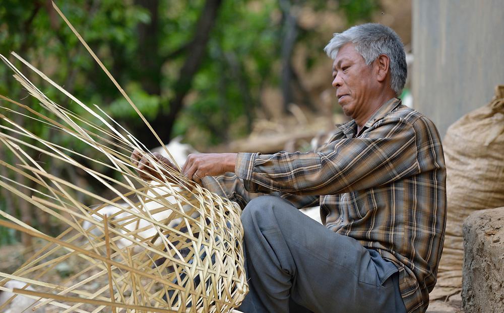 A man makes a basket in Chandragiri, Nepal.