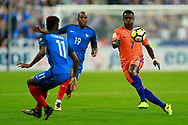 Netherlands' forward Quincy Promes challenges France's forward Kingsley Coman during the FIFA World Cup Russia 2018, Qualifying Group A football match between France and Netherlands on August 31, 2017 at the Stade de France in Saint-Denis, north of Paris, France - Photo Benjamin Cremel / ProSportsImages / DPPI