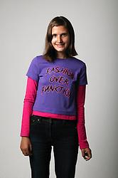 Portrait of teenage girl standing,