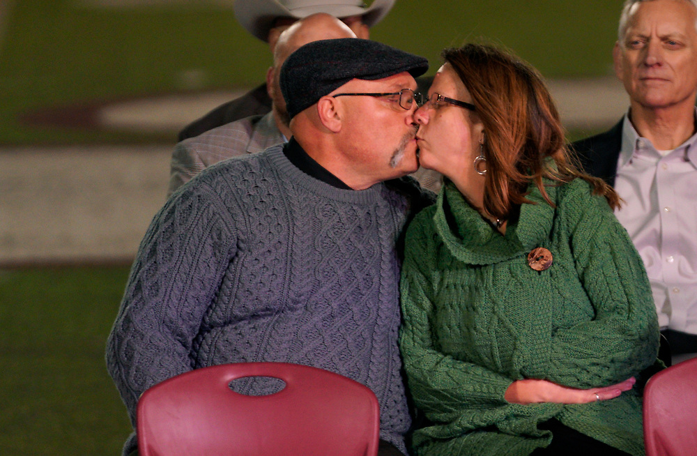 Frank Pomeroy, pastor of First Baptist Church of Sutherland Springs and his wife Sherri kiss at a prayer vigil for the church shooting victims in Floresville, Texas, November 8, 2017.  REUTERS/Rick Wilking