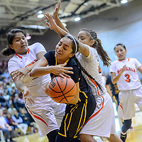Tohatchi Cougar Kalian Mitchell (5) has a ball knocked away under pressure from Gallup Bengals Leona Smith (33), left, and Kamryn Yazzie (20) during the John Lomasney Invitational basketball tournament at Gallup High School Friday.