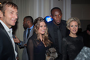 JOCHEN ZEITZ; TARKA RUSSELL; USAIN BOLT; ELIZABETH ESTEVE, Fundraising Gala for the Zeitz foundation and Zoological Society of London hosted by Usain Bolt. . London Zoo. Regent's Park. London. 22 November 2012.