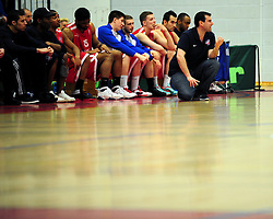 Bristol Academy Flyers' head coach, Andreas Kapoulas crouches in front of the teams bench - Photo mandatory by-line: Dougie Allward/JMP - Tel: Mobile: 07966 386802 23/03/2013 - SPORT - Basketball - WISE Basketball Arena - SGS College - Bristol -  Bristol Academy Flyers V Essex Leopards