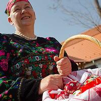 Local woman holds painted eggs prepared for easter celebrations, during a media presentation in Mezokovesd, Hungary on April 5, 2012. ATTILA VOLGYI