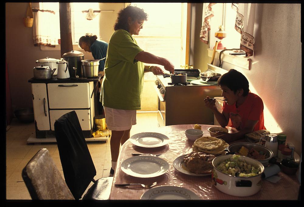 Members of the Paul Keams family prepare food before the start of his Blackening Way Ceremony.