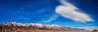 Lenticular cloud in night sky over Alabama Hills, Mt. Whitney and Sierra Nevada Mountains, Owens Valley, California