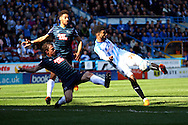 Oscar Gobern of Huddersfield Town (r) shoots and scores his teams 1st goal. Skybet football league championship match, Huddersfield Town v Derby county at the John Smith's stadium in Huddersfield, Yorkshire on Saturday 18th April 2015.<br /> pic by Chris Stading, Andrew Orchard sports photography.